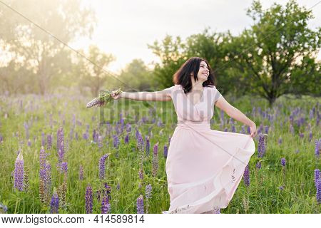 Beautiful Happy Adult Woman Smiling And Dancing In Field. Romantic Female Enjoying Nature Outdoors.