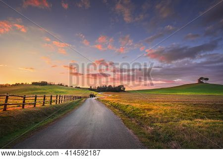 Sunset Landscape In Maremma Countryside. Road And Rolling Hills. Bibbona. Tuscany, Italy, Europe
