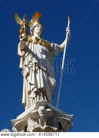 A Monument From Pallas Athene Is Standing In Front Oft The Parliament In Vienna
