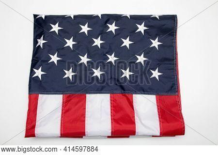 Usa Flag Folded On White Background. American Flag Folded On White Background. Memorial Day Concept