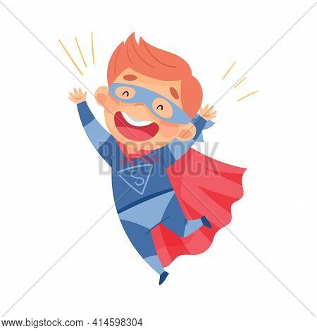 Cute Boy Wearing Cape And Mask As Superhero Jumping With Joy Pretending Having Power For Fighting Cr