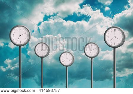 Street Clock On The Background Of The Cloudy Sky. Showing Different Times. Planning Concept. Time Ma