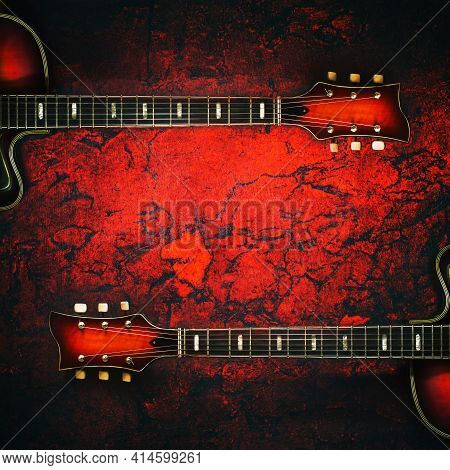Two Old, Jazz Electric Guitars On A Red Grunge Background. Copy Space. Background For Music Festival