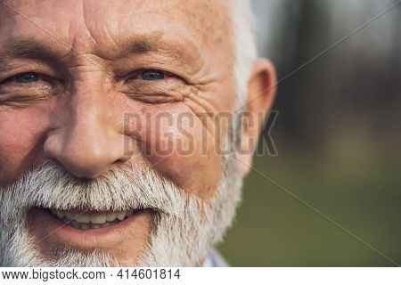Close Up Portrait Of Happy Senior Man. Part Of Senior Man Face With Copy Space On Image.