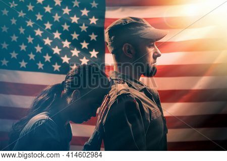 Memorial Day.the Woman Leans Her Head On The Soldier's Back,holding On To Him With Her Hand.couple O