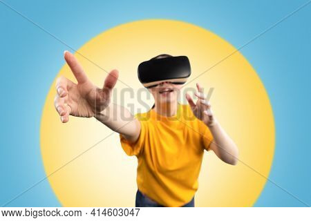 A Young Woman Wearing Virtual Reality Glasses, Reaching Out With Her Hands, Trying To Reach Somethin