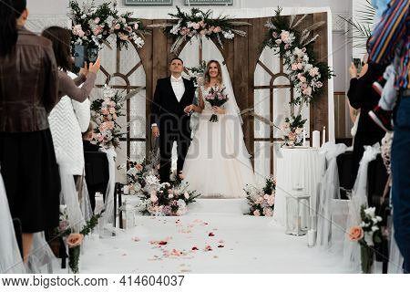 Two Loving Hearts Together At A Wedding Ceremony. The Groom With The Bride On The Background Of The