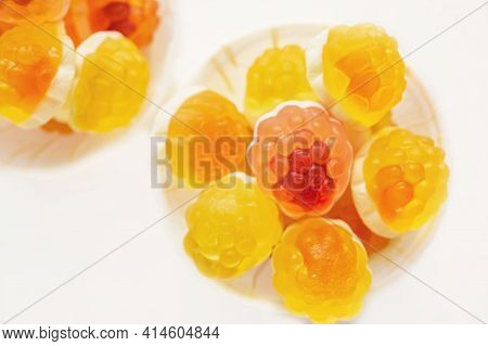 Macro Photography Of Jelly-like Craft Marmalade With Orange Juice. The Sweetness Of Yellow And Orang
