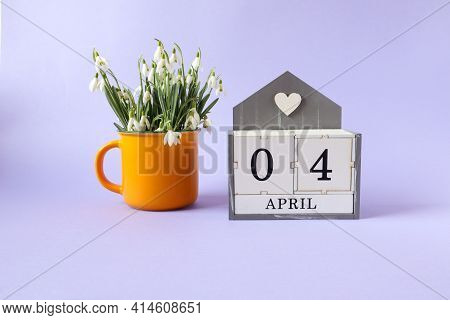 Calendar For April 4: Cubes With The Numbers 0 And 4, The Name Of The Month Of April In English, A B