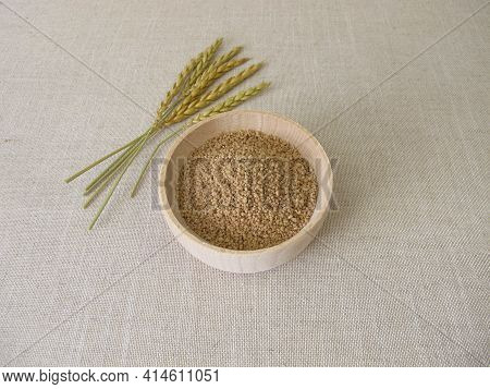 Uncooked Spelt Couscous In A Wooden Bowl And Spelt Ears