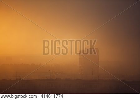 Cityscape With Sunset And Mist. Evening Townscape.