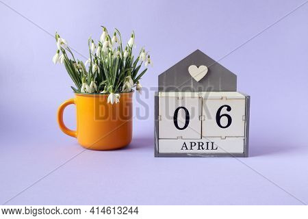 Calendar For April 6: Cubes With The Numbers 0 And 6, The Name Of The Month Of April In English, A B