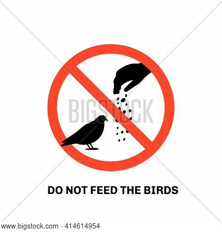 Prohibition Sign With Text Do Not Feed The Birds And Hand Silhouette Giving Food To Pigeon