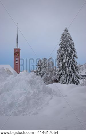 Tower Of A Catholic Church Protrudes Behind A Heap Of Snow In Buchs In Switzerland 15.1.2021
