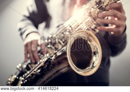 Saxophonist musician playing a saxophone