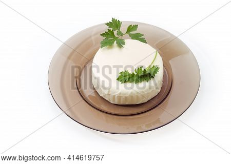 Ball Of Fresh Mozzarella Cheese, That Was Soaked In Whey Decorated With Parsley Twig On Glass Dish O