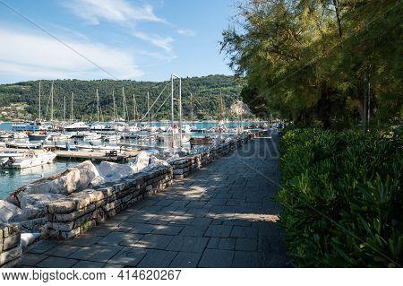 Portovenere, Liguria, Italy. June 2020. View Of The Seascape:  Moored Boats, The Green Hills Surroun