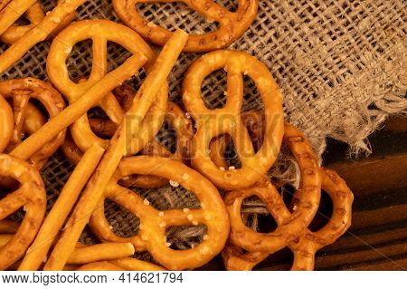 Salted Breadsticks And Salted Pretzels Scattered On The Table. Close-up Selective Focus.