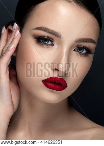 Young Woman With Red Matte Finish Lips Closeup Beauty Portrait