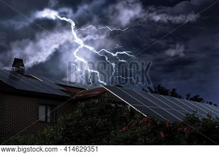 Dark Cloudy Sky With Lightning Over House. Stormy Weather