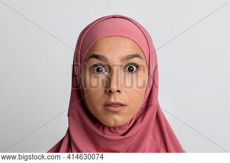 Astonishment. Closeup Portrait Of Surprised Muslim Woman In Hijab Looking At Camera