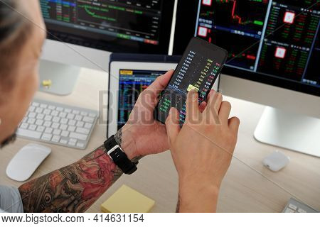 Close-up Image Of Trader Checking Stock Market Data Via Application On Smartphone, Buying And Sellin