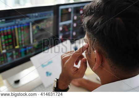 Pensive Trader Analyzing Chart And Thinking What Stock To Buy When Market Is Opened