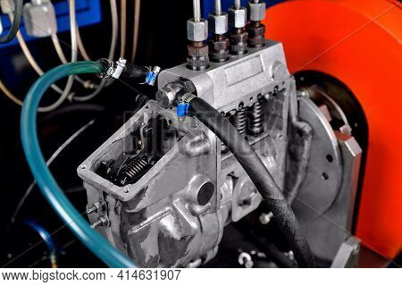 A Fuel Pump For A Diesel Engine After Repair On An Adjustment Stand In A Workshop, Fuel Pump Repair,