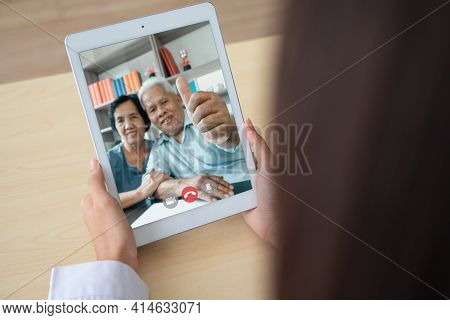 Doctor Online Video Conference With The Old Elderly Patient To Monitor And Ask For Symptoms Of The D
