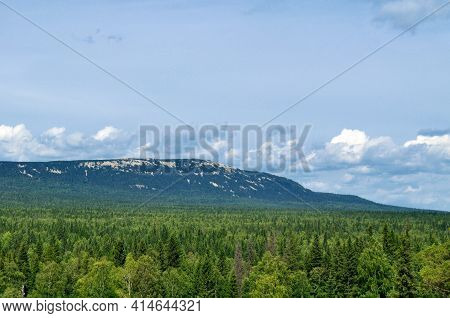 Mountain landscape,mountain view.Summer mountain landscape,mountain landscape view of Zyuratkul Ridge in Southern Urals, Russia.Mountain view,mountain scene,cloudy mountain nature,mountain panorama,mountain background