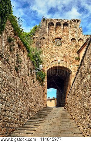 A Stone Gate, Stairs And A Narrow Street  In The City Of Massa Maritima In Italy