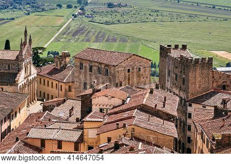 View Of The Houses And The Church From The Castle Tower Of The City Of Massa Maritima In Tuscany