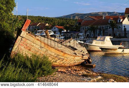 Abandoned Fisherman Boat On The Coastline Of Inland Sea Channel In Vrboska Villag, Hvar Island, Dalm