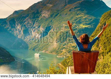 Tourism Vacation And Travel. Female Tourist Enjoying View Over Geirangerfjord From Flydalsjuvet View