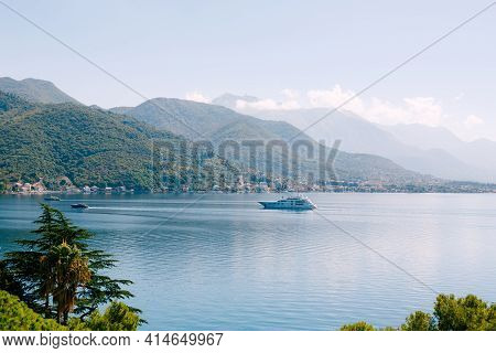 A Huge Expensive Yacht In The Bay Of Kotor In Montenegro, Against The Backdrop Of The City Of Tivat