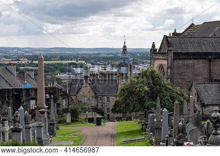 The Cityscape Or Stirling Town In Scotland, Uk With Graveyard And The Clock Tower Of Tolbooth In Bac
