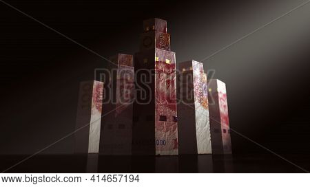 A Concept Depicting Origami Skyscrapers Formed From Folded  China Yuan Banknotes On A Dark Moody Spo