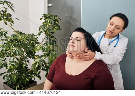Endocrinologist Palpates Woman Patients Thyroid Gland. Diagnosis Of Thyroid Diseases, Hypothyroidism