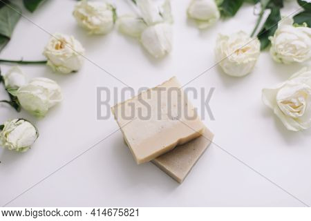 Handmade Natural Floral Soap And Roses On White Background. Soap Making. Soap Bars. Spa, Skin Care.