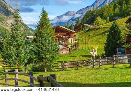 Traditional Wooden Houses And Wooden Fence In Zermatt, Alpine Village, Switzerland, Swiss Alps Summe