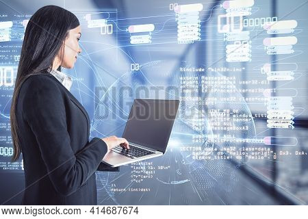 Software Development And Coding Concept With Programmer Working On Laptop In Front Of Digital Screen