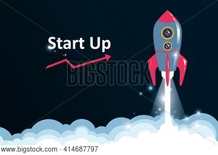 Start Up And Business Idea Concept With Taking Of Handwritten Rocket And Phrase Start Up On Dark Bac