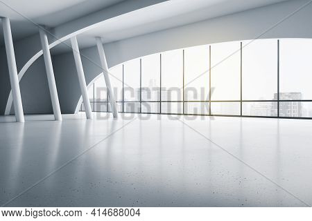 Modern Empty Exhibition Hall With White Columns On Glossy Floor And Sunny City View From Transparent