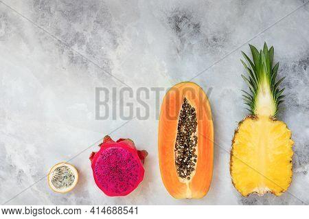 Tropical Fruits On A Gray Background. Pineapple, Papaya, Dragon Fruit, Passion Fruit Cutaway.