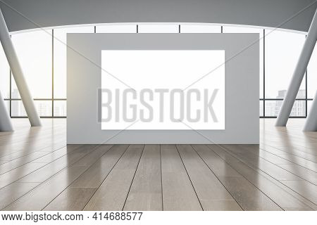 Blank White Poster On Grey Partition In Sunny Spacious Hall With Wooden Floor And City View. 3d Rend