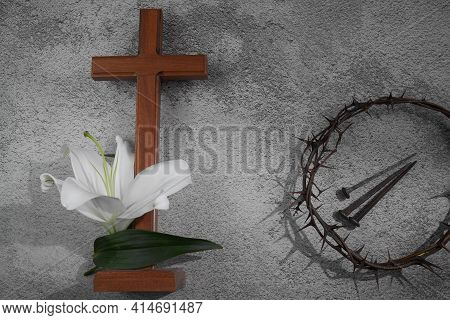 Cross With White Lilies And Crown Of Thorns On Grey Background. Christianity Easter Concept.