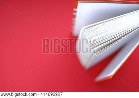 Reading Books.learning And Knowledge. Book With A Red Cover On A Red Background.books Close Up. Book