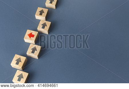Red Arrow Stands Out From The Others And Changes Direction To Go Out Of Order. Thinking Outside The