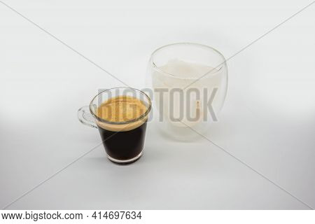 Espresso In A Glass Shot With Fresh Coconut Juice In Double Walls Glass Isolated On White Background