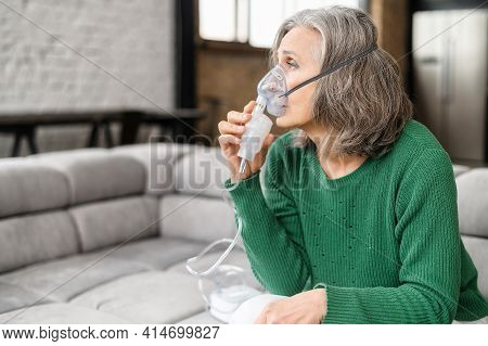 Upset Senior Woman Feeling Unwell, Has Shortness Of Breath, Asthma, Using Oxygen Mask Sitting On The